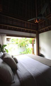 A bed or beds in a room at Asmara Villa