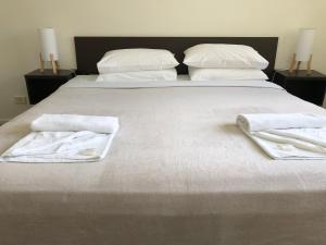 A bed or beds in a room at Splendido Resort Apartments