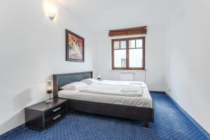 Łóżko lub łóżka w pokoju w obiekcie Sopockie Apartamenty - Aurora