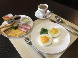 Breakfast options available to guests at Erunin Hotels Group, Tolstogo 77