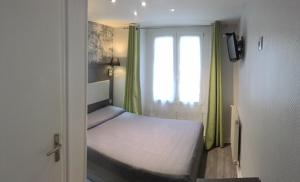 A bed or beds in a room at Mary's Hotel République