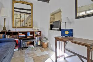 A television and/or entertainment center at Uzès Townhouse with Loggia & Views
