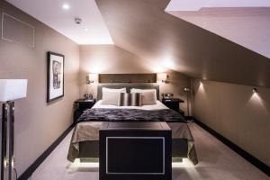 A bed or beds in a room at The Chester Hotel