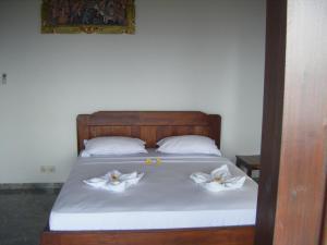 Ein Bett oder Betten in einem Zimmer der Unterkunft Bubu Racok Homestay