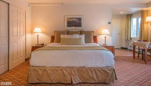 A bed or beds in a room at Anchorage Grand Hotel