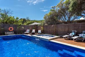 The swimming pool at or near Front Beach House