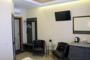 A seating area at Erunin Hotels Group, Samotechnaya 29A