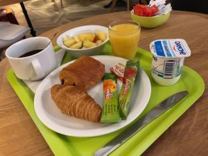 Options de petit-déjeuner proposées aux clients de l'établissement ibis budget Annecy Poisy