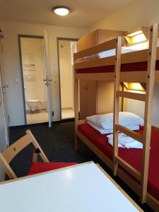 A bunk bed or bunk beds in a room at CVJM Jugendgästehaus Berlin