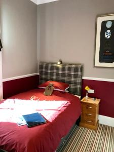 A bed or beds in a room at Dairy Guest House