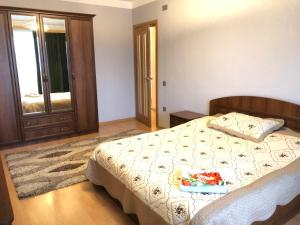 Cama ou camas em um quarto em Uzeyir Hajibeyov 33 Avenue