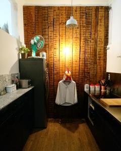 A kitchen or kitchenette at Goodnight Hostel