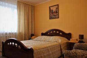 Кровать или кровати в номере Гостиница Юность