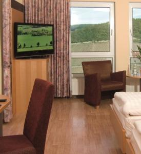TV/Unterhaltungsangebot in der Unterkunft Burg-Hotel