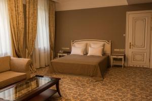 Кровать или кровати в номере Бизнес Клуб Отель Разумовский