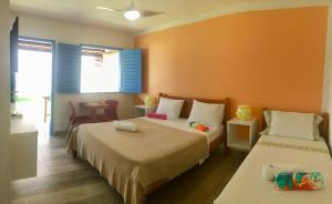 A bed or beds in a room at Pousada Annaluz