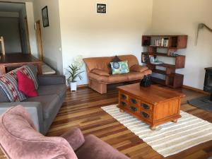 A seating area at Apostle Hideaway - Central Port Campbell