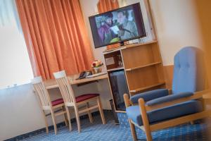 A television and/or entertainment center at Hotel Kern Buam
