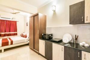 A kitchen or kitchenette at Octave Studio Hotel