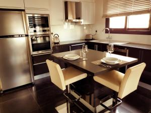 A kitchen or kitchenette at Nicosia Center Cozy Short Stays