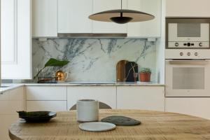 A kitchen or kitchenette at Alfama-Baixa-Chiado A/C 2 Bedrooms& 2 Bathrooms