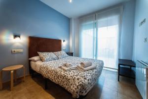 A bed or beds in a room at Apartamentos Amanecer Murcia