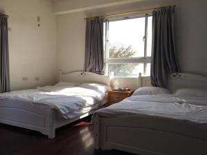 A bed or beds in a room at manor