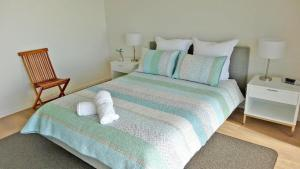 A bed or beds in a room at Millpond.