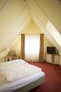 Ein Bett oder Betten in einem Zimmer der Unterkunft Bad Hotel Bad Überkingen