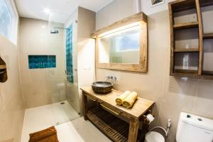 A bathroom at Pesona Beach Resort & Spa