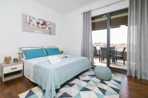 A bed or beds in a room at Spada Residence III