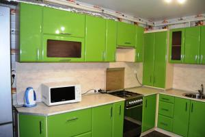 A kitchen or kitchenette at 1-комнатная в Новом доме!