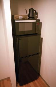 A kitchen or kitchenette at Art Apartment AOCA Sanno MHAK