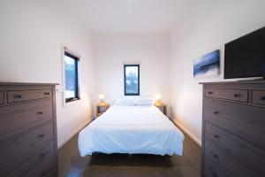 A bed or beds in a room at Sawyers Bay Shacks