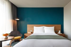 A bed or beds in a room at L7 Hongdae by LOTTE