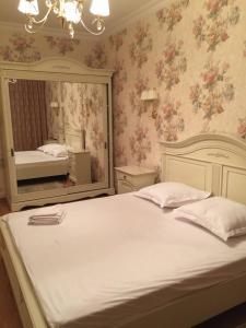 A bed or beds in a room at Lesya Apartment with Terrace