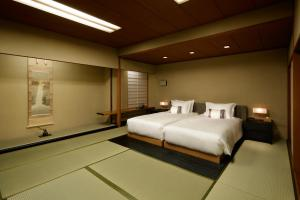A bed or beds in a room at Grand Prince Hotel Takanawa Hanakohro