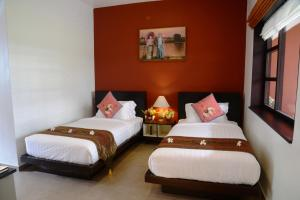 A bed or beds in a room at Bagan Star Hotel