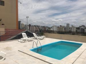 The swimming pool at or near Hotel Flat Petras Residence