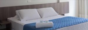 Cama ou camas em um quarto em Monza Palace Hotel
