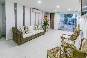 A seating area at Hotel Casa Vallecaucana