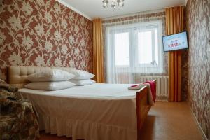 A bed or beds in a room at Apartment on ulitsa Orlova 27