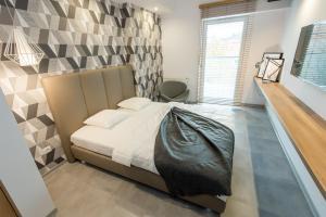 Łóżko lub łóżka w pokoju w obiekcie Super-Apartamenty Luxury
