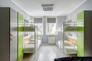 A bunk bed or bunk beds in a room at Hostel Cycle On