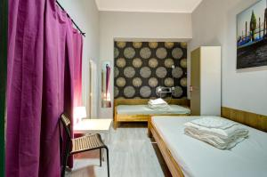 A bed or beds in a room at Hostel Cycle On