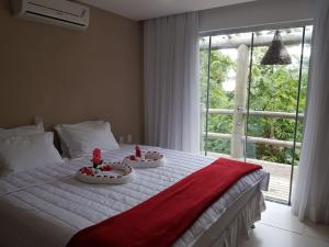 A bed or beds in a room at Villas Supreme Flats