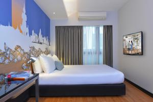 A bed or beds in a room at Citadines Sukhumvit 11 Bangkok