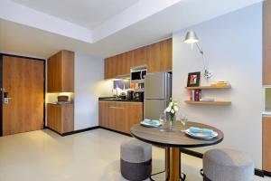 A kitchen or kitchenette at Citadines Sukhumvit 11 Bangkok
