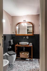 Ein Badezimmer in der Unterkunft Bozzi 1910