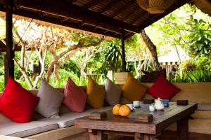 A seating area at La Taverna Suites